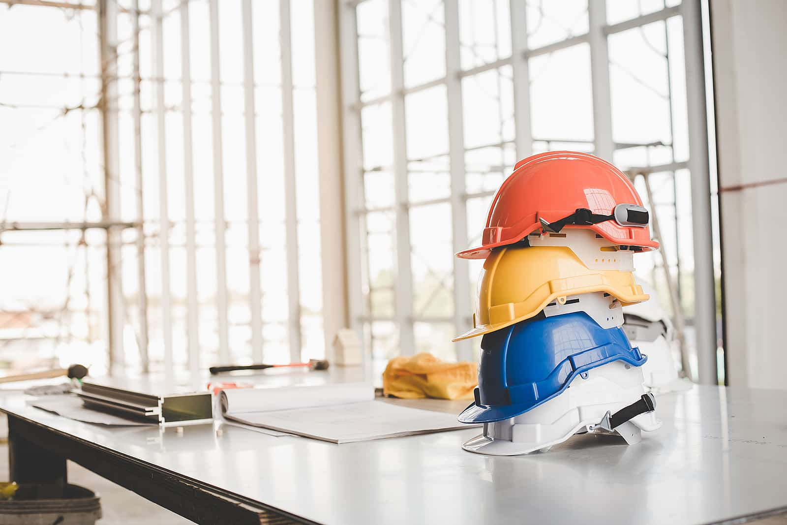 Yellow,white, Blue, Orange helmet safety engineer for project engineering.Conceptual images of construction engineer projects and engineering safety tools.